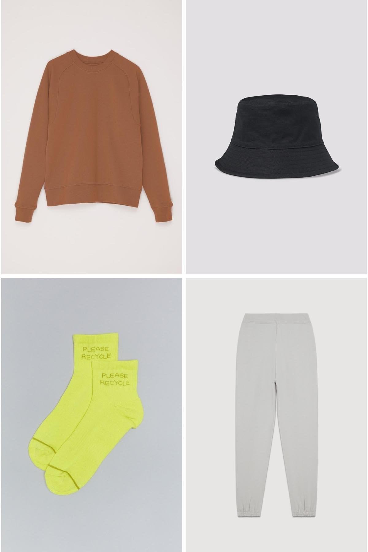 brown crewneck sweatshirt, black bucket hat, neon green socks, and grey sweatpants