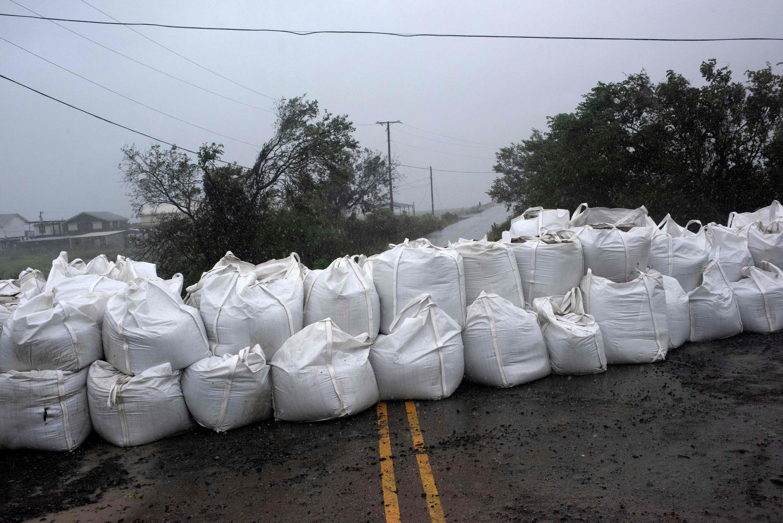 Rain comes down at a wall of sandbags in Montegut, Louisiana before Hurricane Ida lands