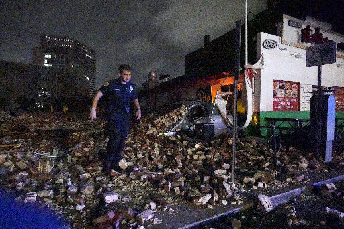 Police detective looks over debris from a building that collapsed during Hurricane Ida in New Orleans