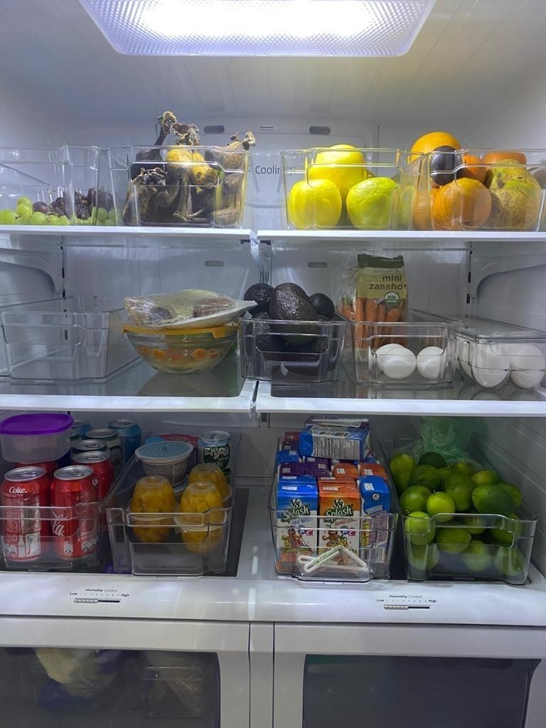 A customer's fridge filled with several pantry organizers