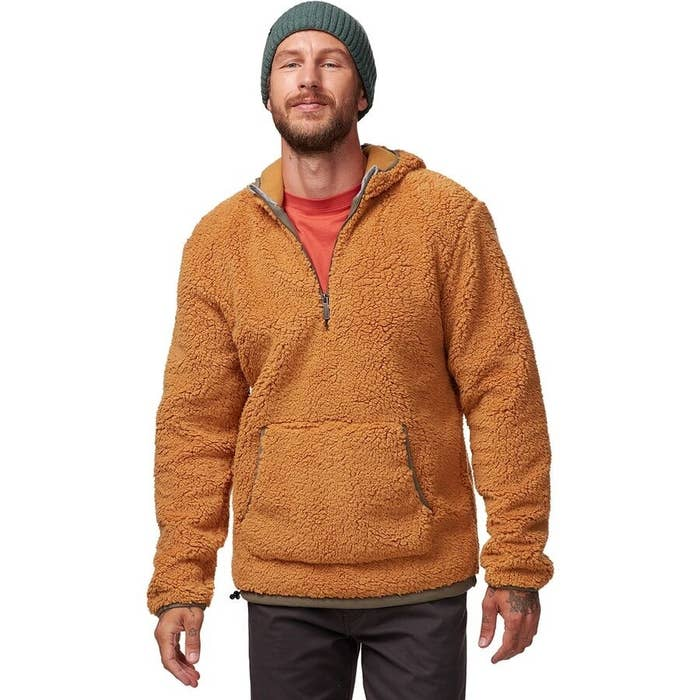 model wearing the pullover in bone brown