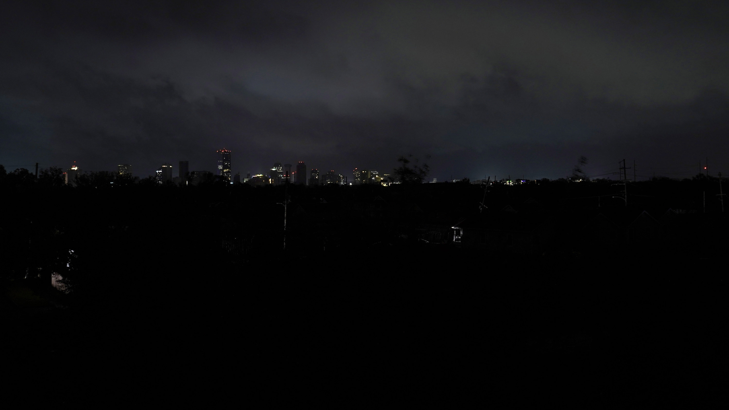 Downtown buildings relying on generator power are seen as the entire city of New Orleans is without power in the aftermath of Hurricane Ida