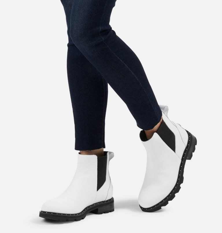model wearing white boots with black elastic on the sides