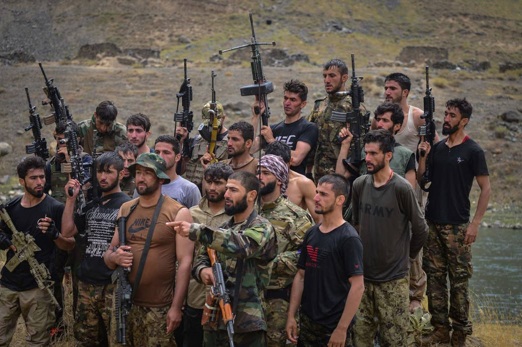 Taliban resistance soldiers hold guns and participate in a training