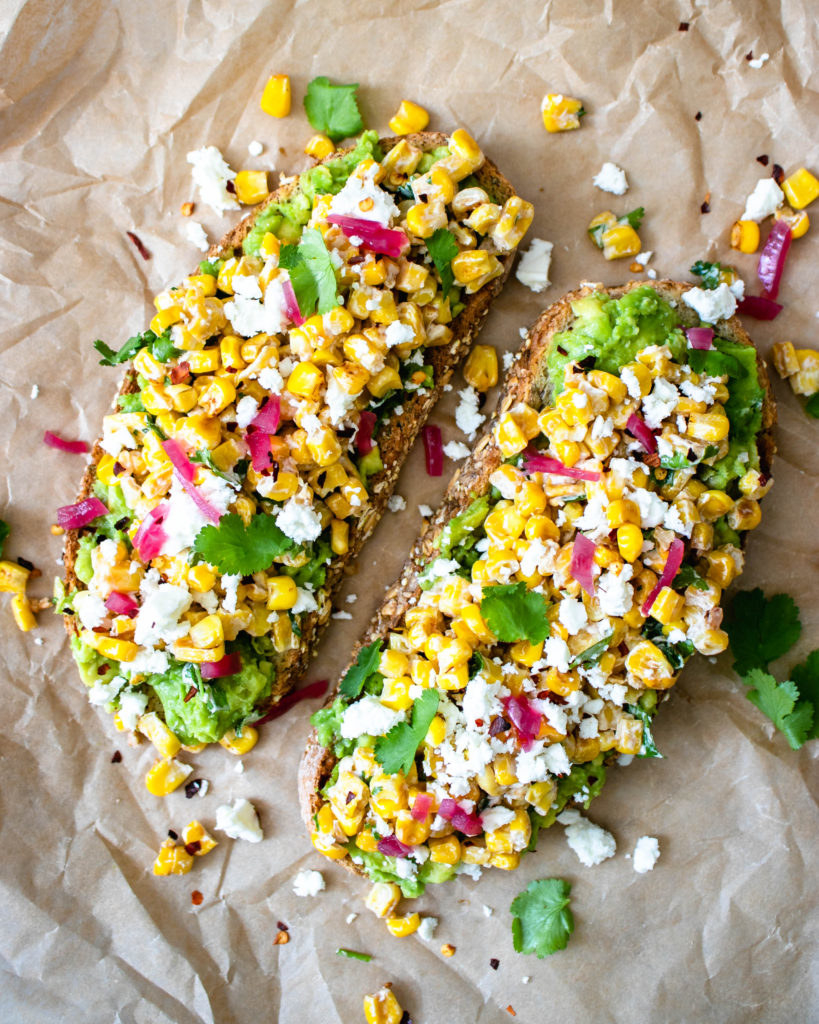 Avocado toast topped with Mexican street corn.