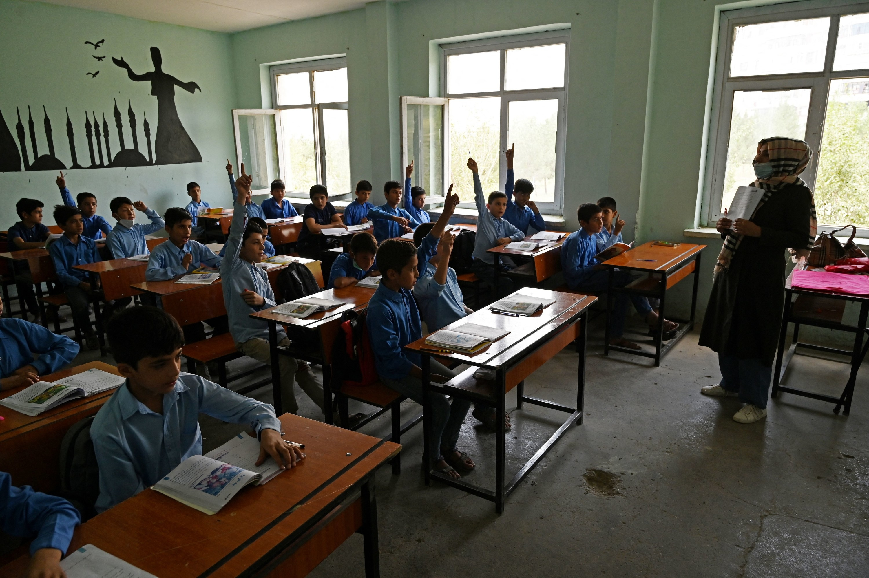 Afghan students participate in class at a middle school