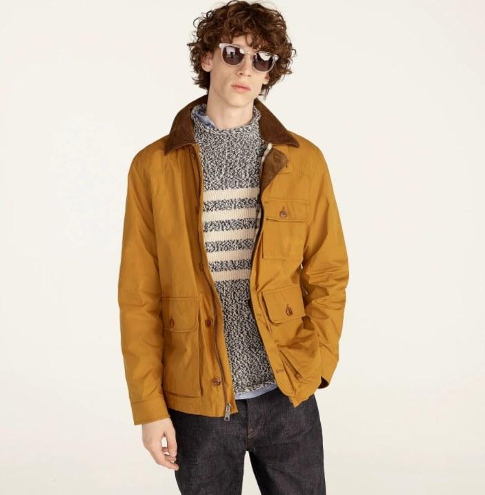 model wearing the jacket in burnt saffron