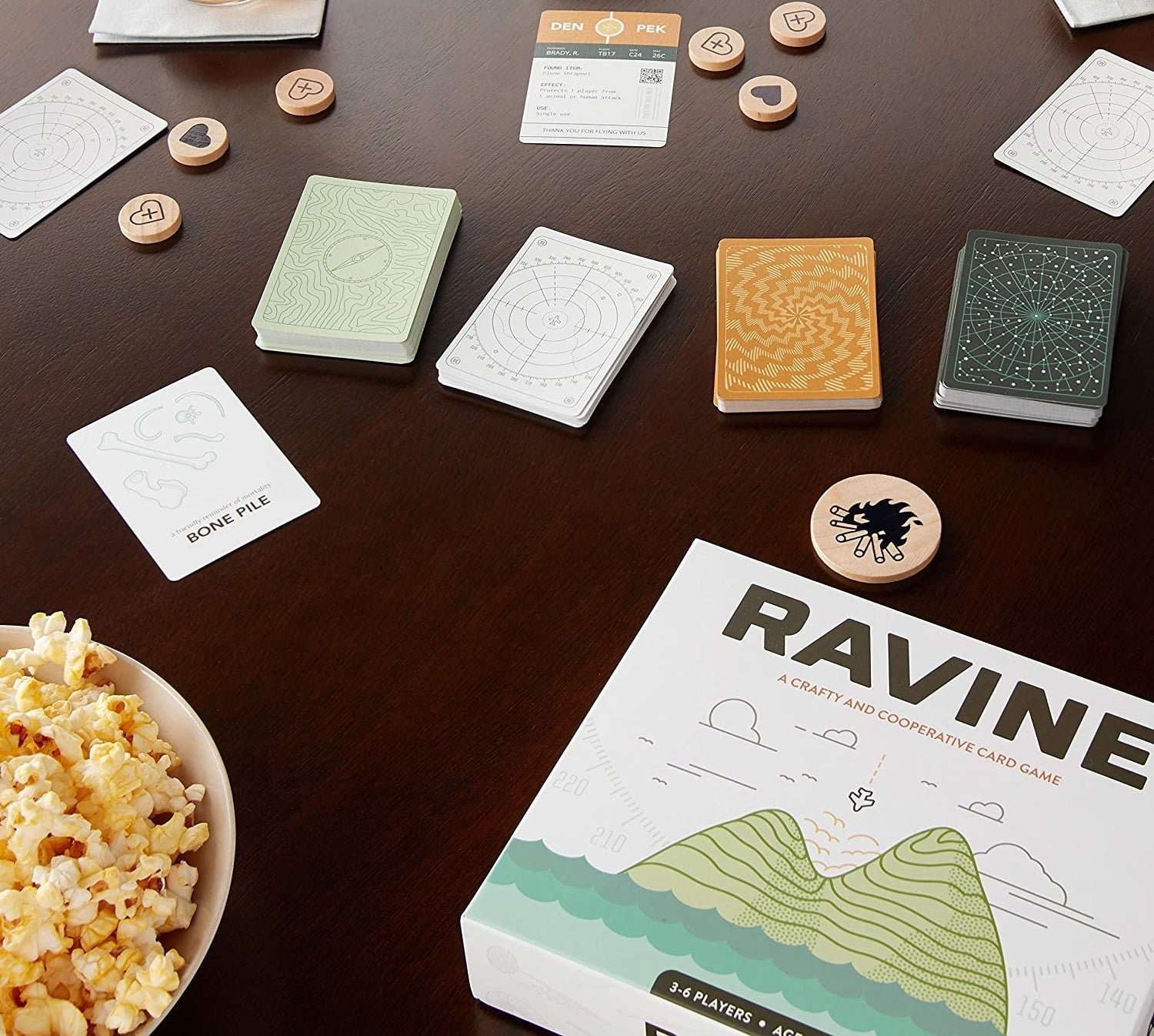 the game table box on a table with different cards