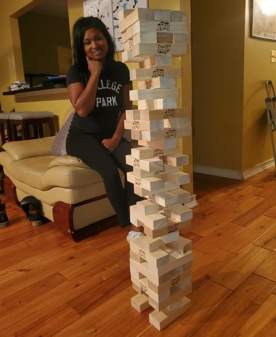 a reviewer photo of the large jenga set being played with