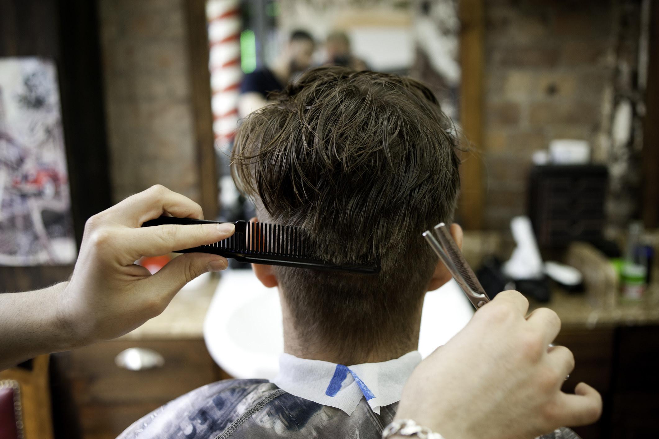 Getting a hair cut at a barbershop