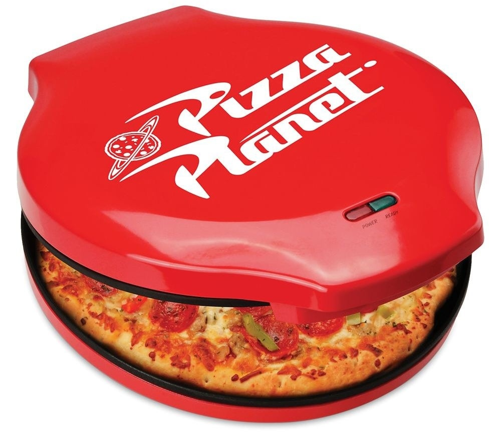 the round red pizza maker with a Pizza Planet logo on top