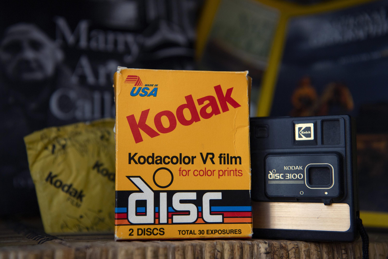Kodak color film next to a Kodak disc 3100 camera