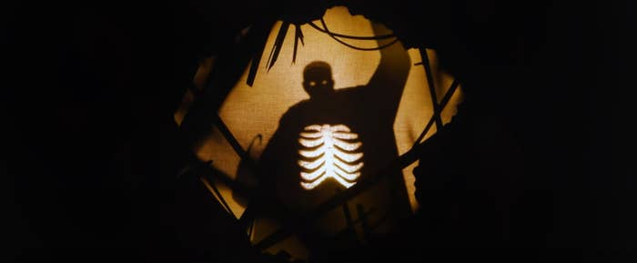 Paper cut out silhouette of the candyman, his rib cage and hook showing