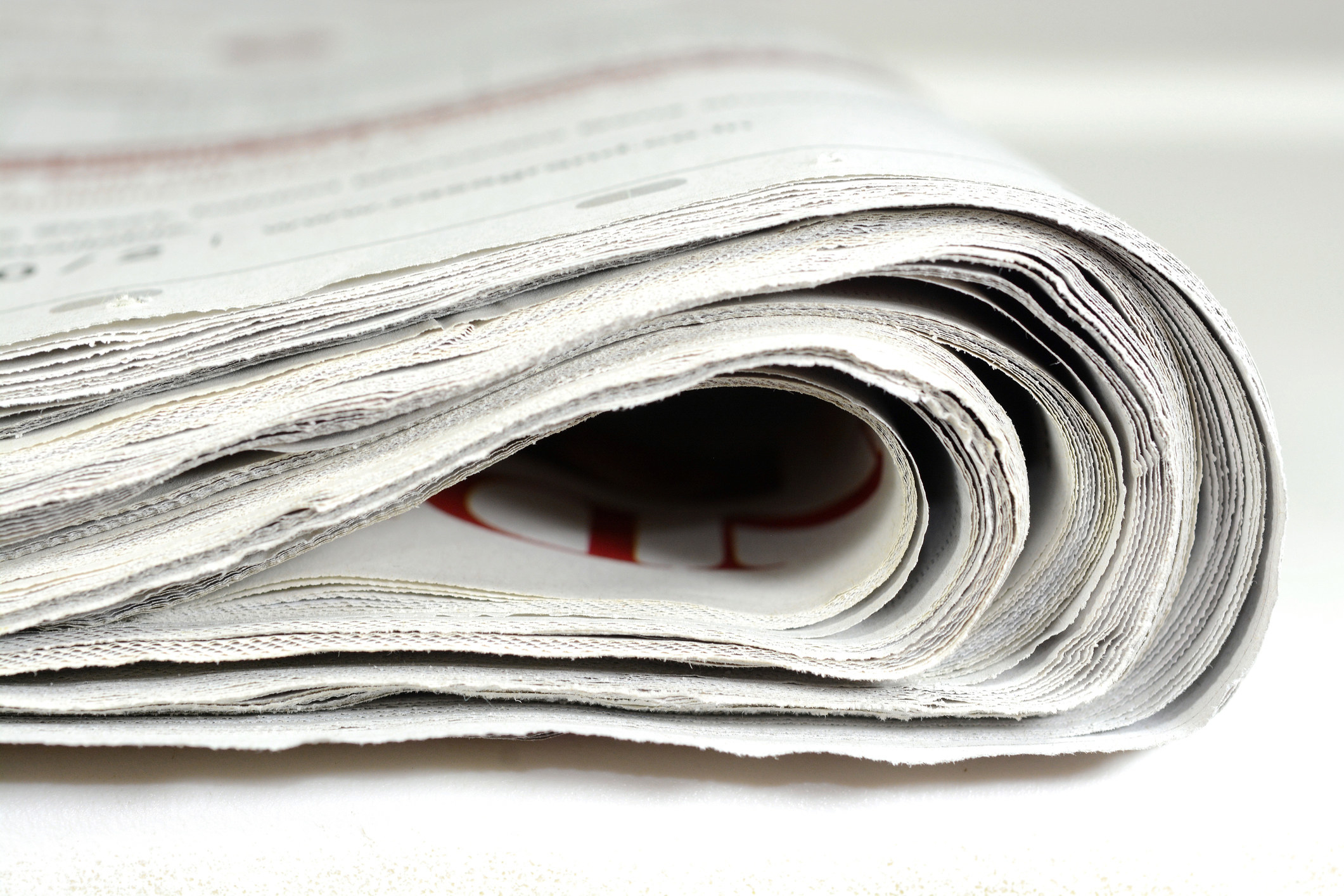 A bunch of newspapers folded together