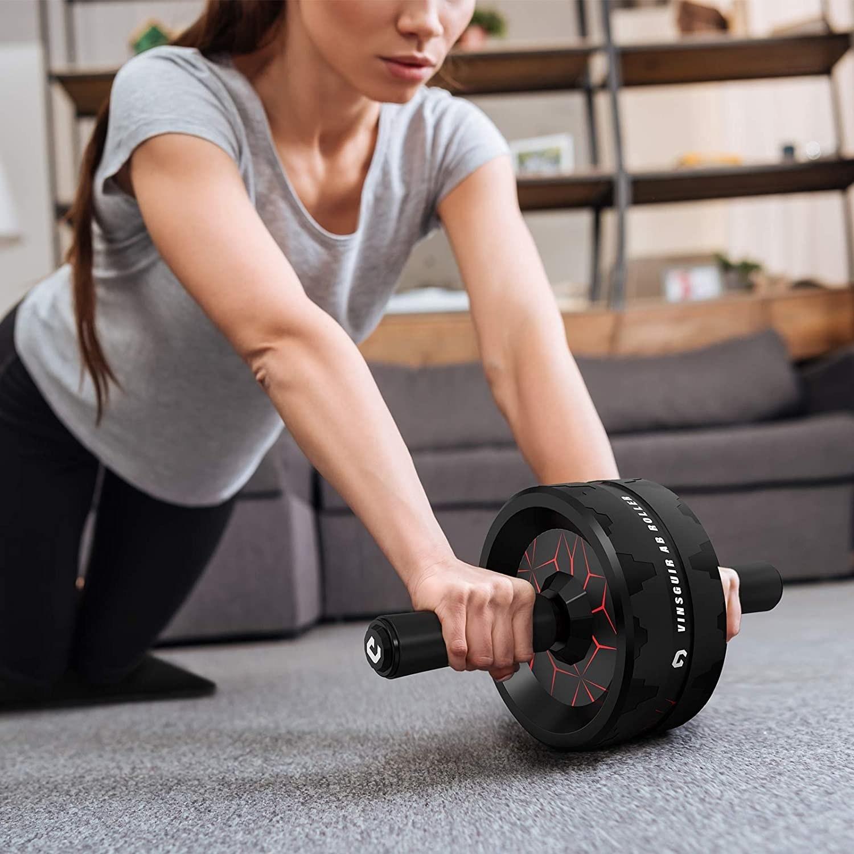 model exercises on carpet with black ab roller wheel