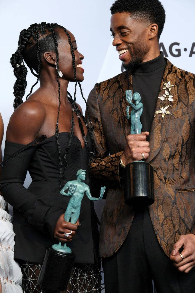 Lupita Nyong'o (L) and Chadwick Boseman at the SAG awards holding their trophies