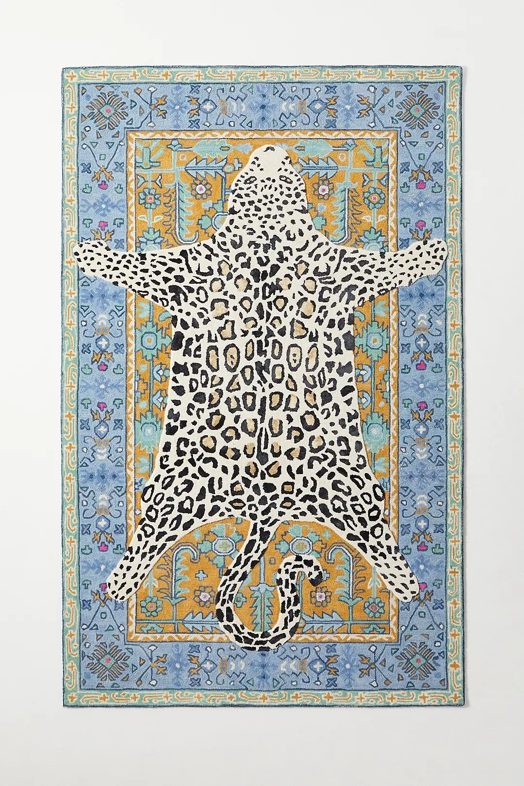 multi colored area rug with leopard hide print over traditional Turkish pattern