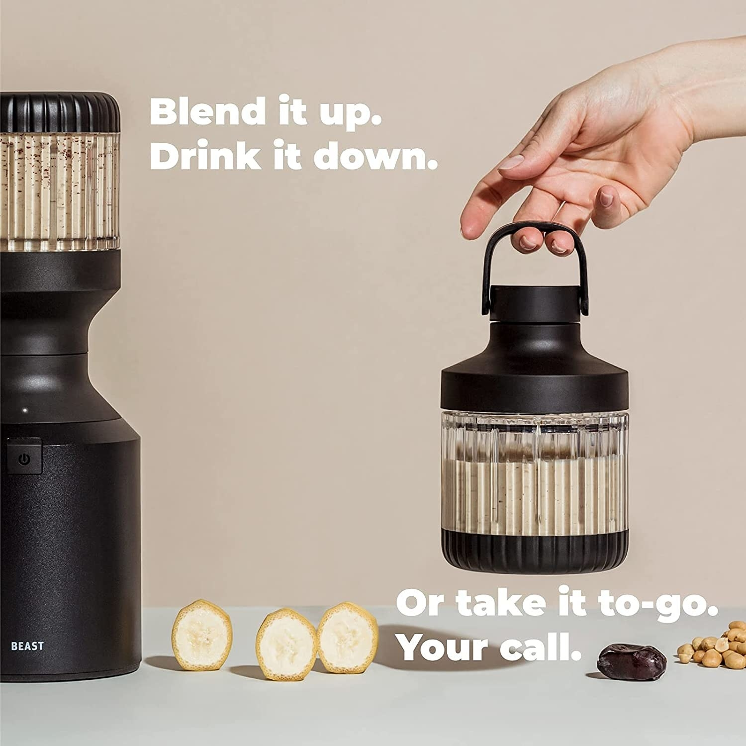 The blender in black with the on-the-go lid with handle