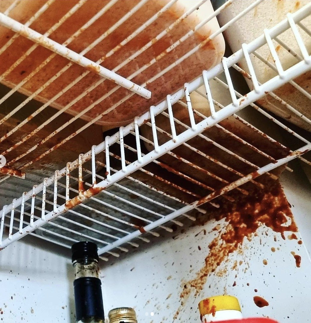 photo of tomato sauce splattered all over the fridge