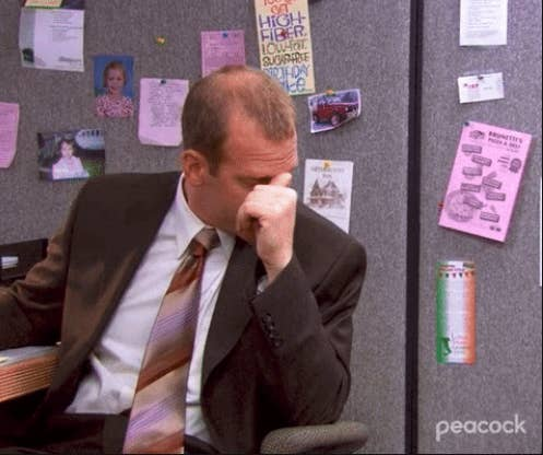 """Toby holding his temple in frustration on """"The Office"""""""