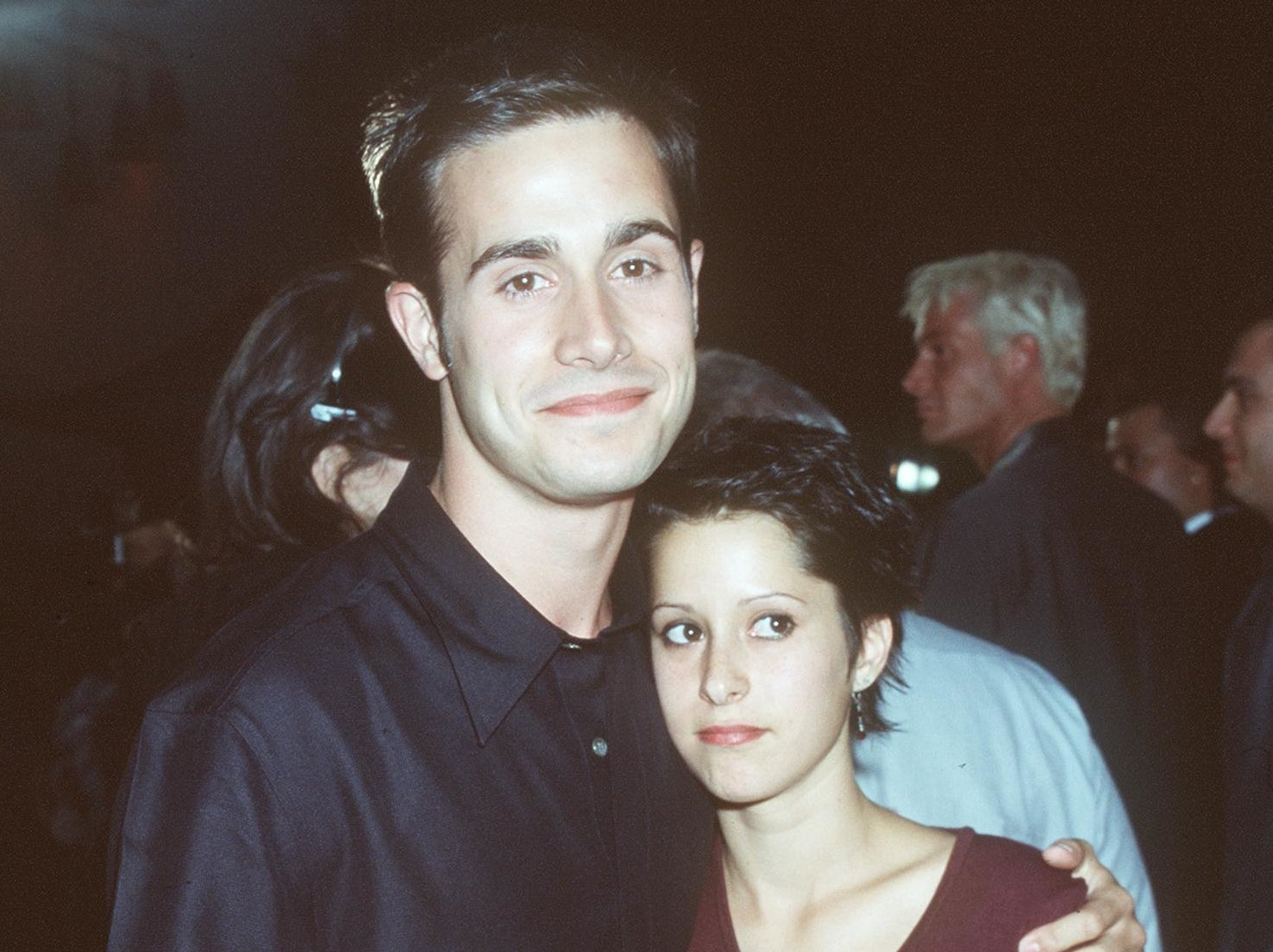 Freddie poses with Kimberly who has a similar short black haircut