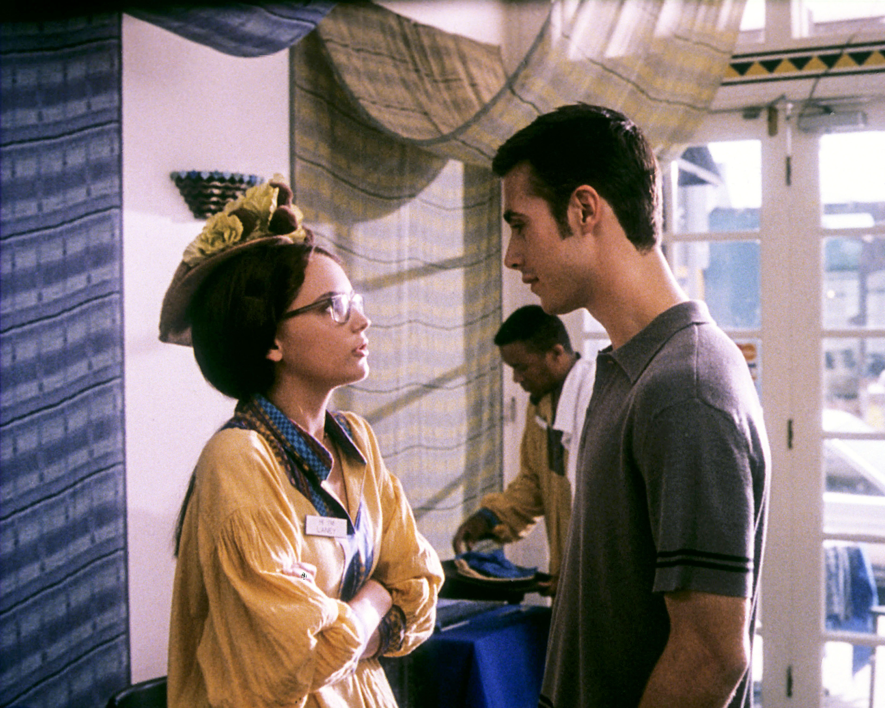 Rachael and Freddie look at each other in a screenshot from She's All That