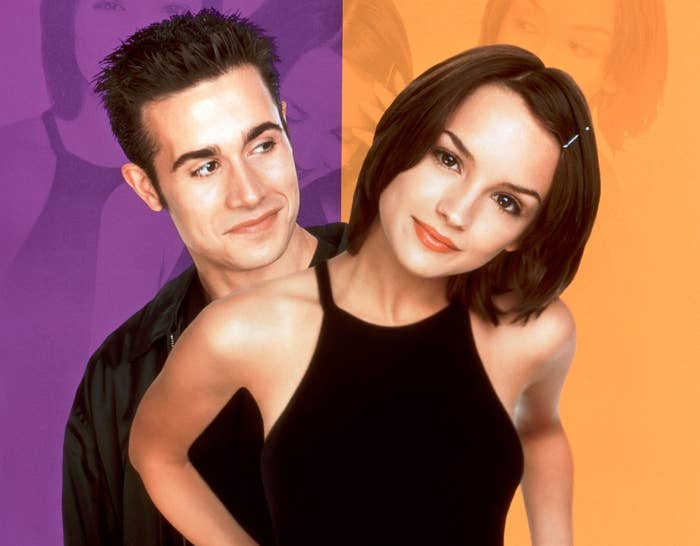 The She's All That movie poster where the duo poses on a purple and orange background
