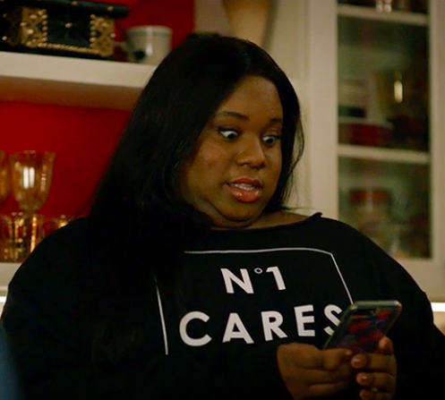 """Mo in """"Zoey's Extraordinary Playlist"""" cringing at the phone"""