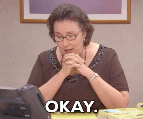 """Phyllis looking upset and saying okay on the phone from """"The Office"""""""