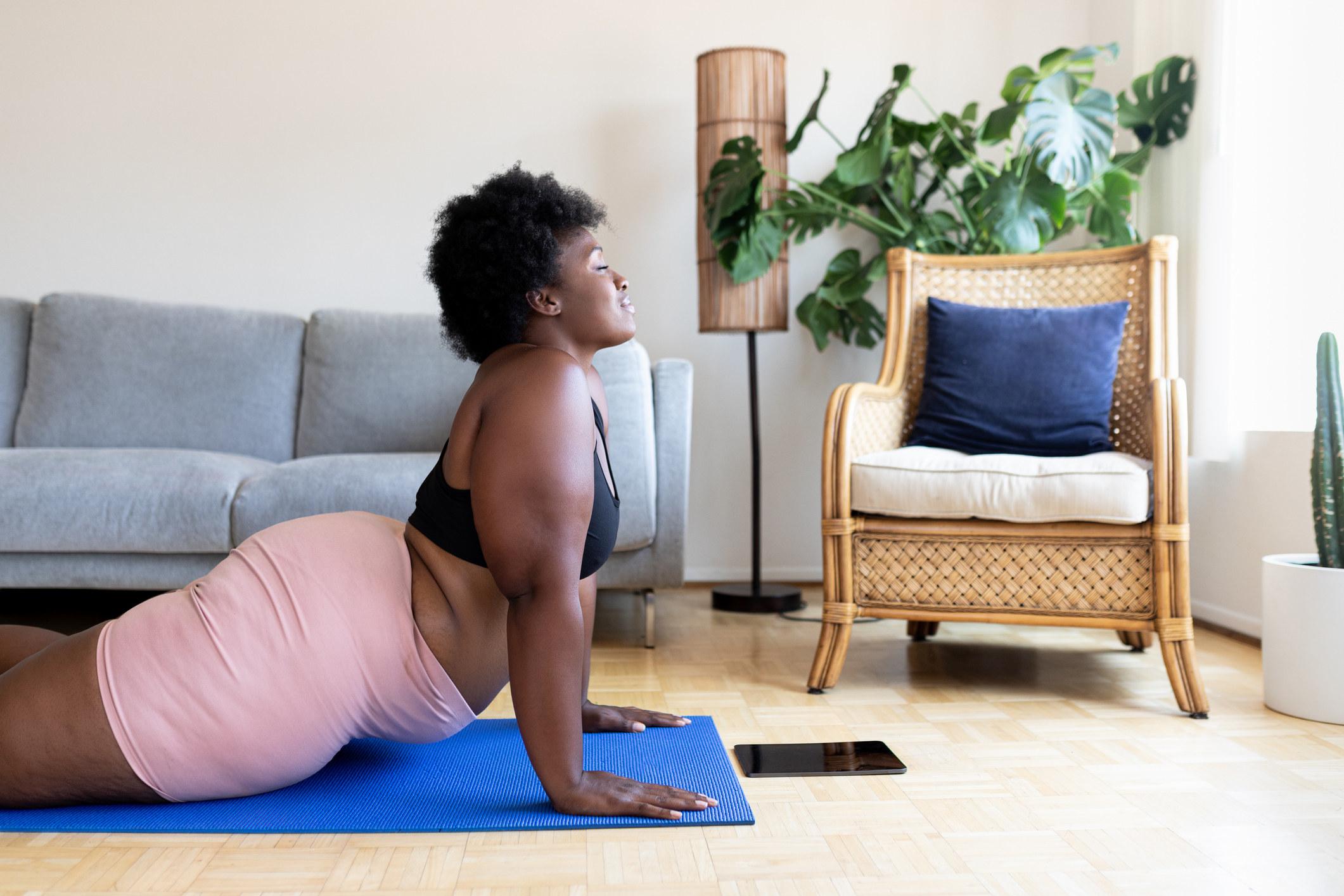 A woman doing yoga on the floor
