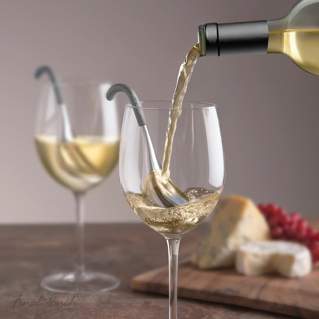 A pair of chilling spoons inserted into wine glasses
