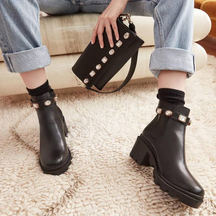 model wearing the chunky black boots with jewels around the ankle