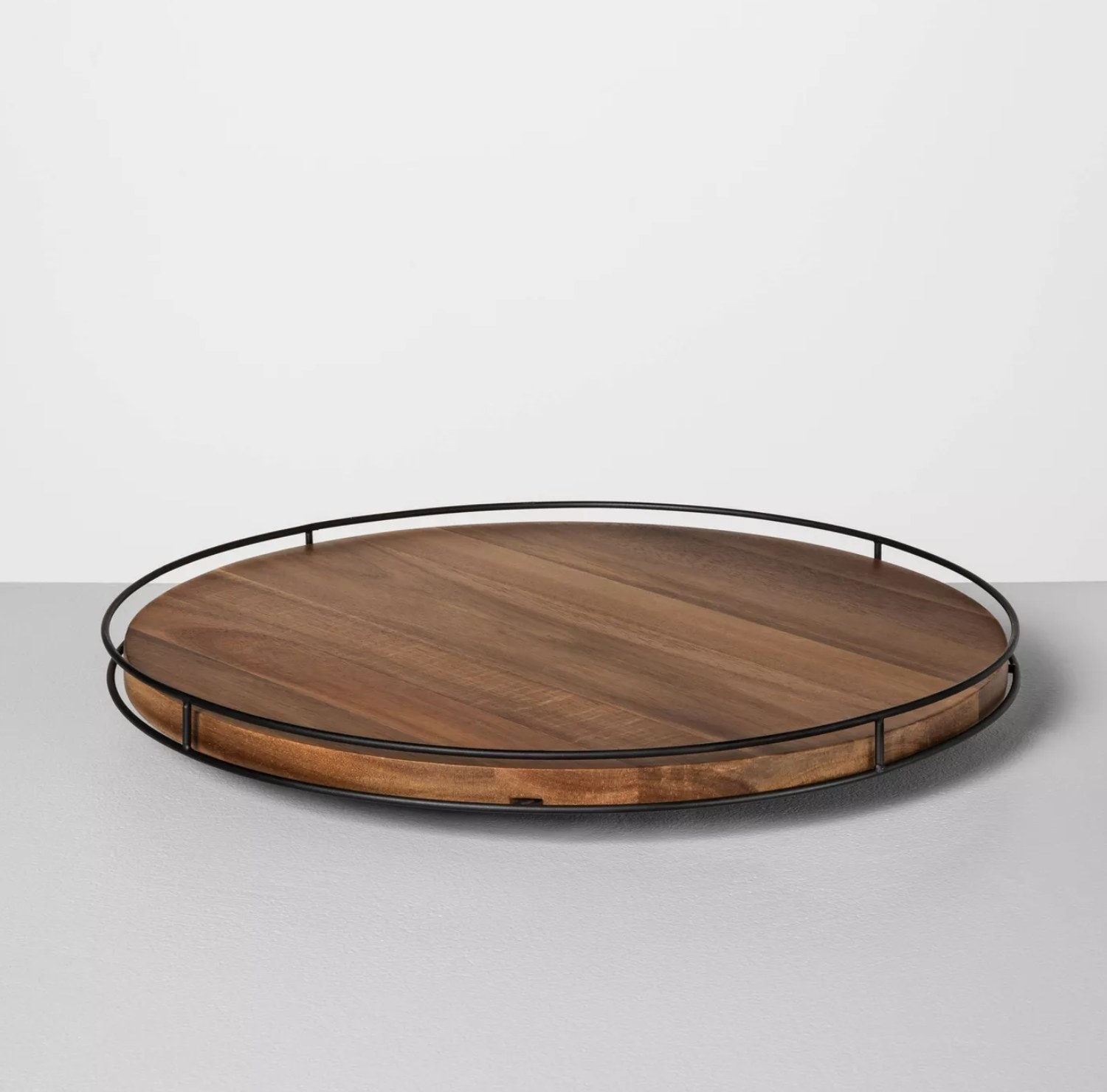 the wooden tray with black wiring around the edges