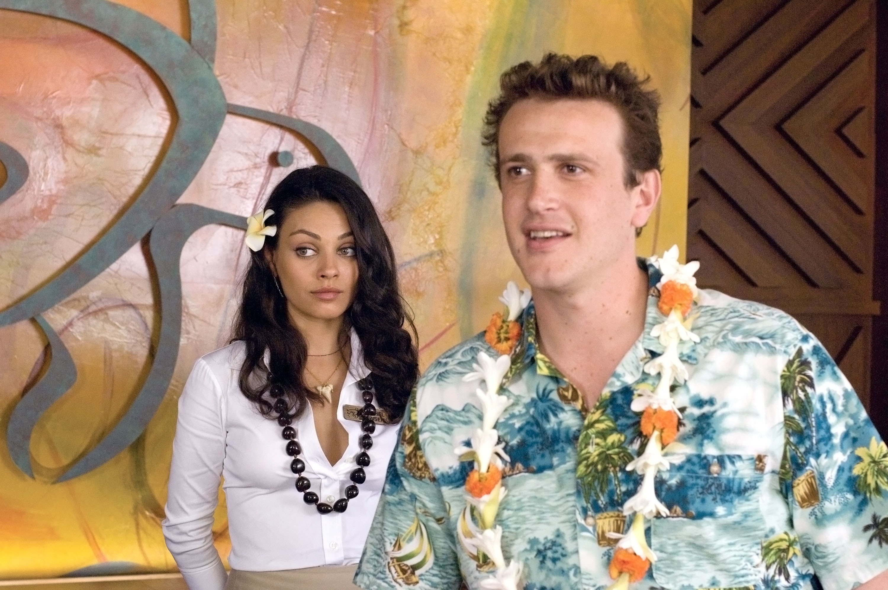 Mila Kunis and Jason Segel wearing tropical clothes