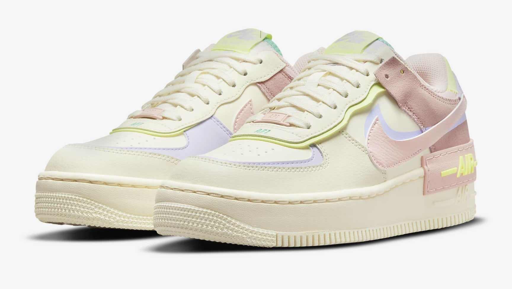 platform sneakers in cream with pink, yellow, and purple design features throughout