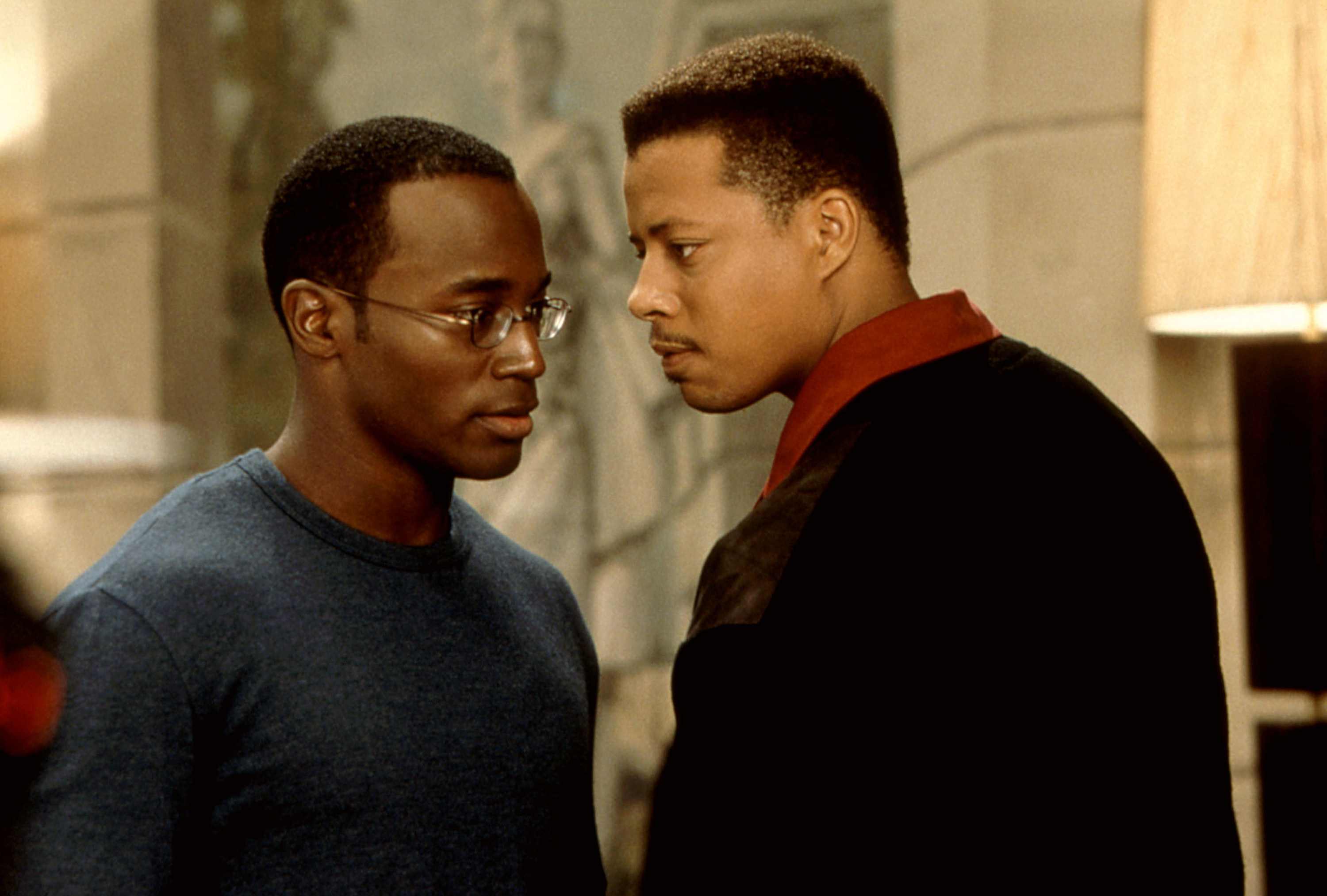 Taye Diggs and Terrence Howard stare at each other