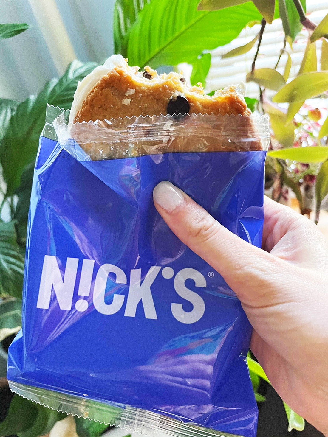 buzzfeed editor holding nick's ice cream cookie sandwich in plastic packaging