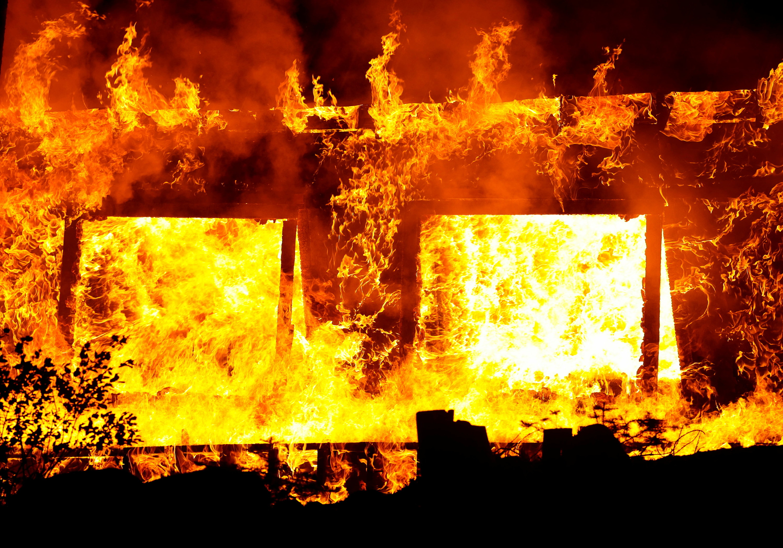 Flames violently destroy a structure