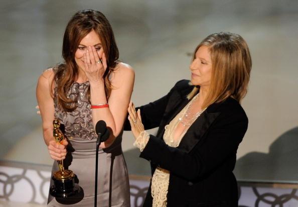 Barbara Streisand presenting Kathryn Bigelow with an award