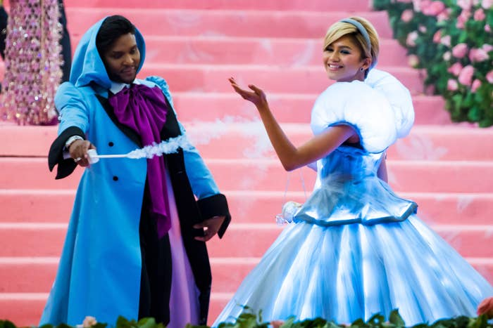 Law Roach dressed as Fairy Godmother while his client Zendaya is Cinderella at the Met Gala