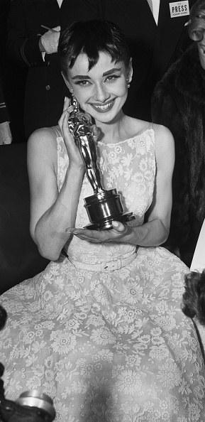 Audrey Hepburn showing off her Oscar