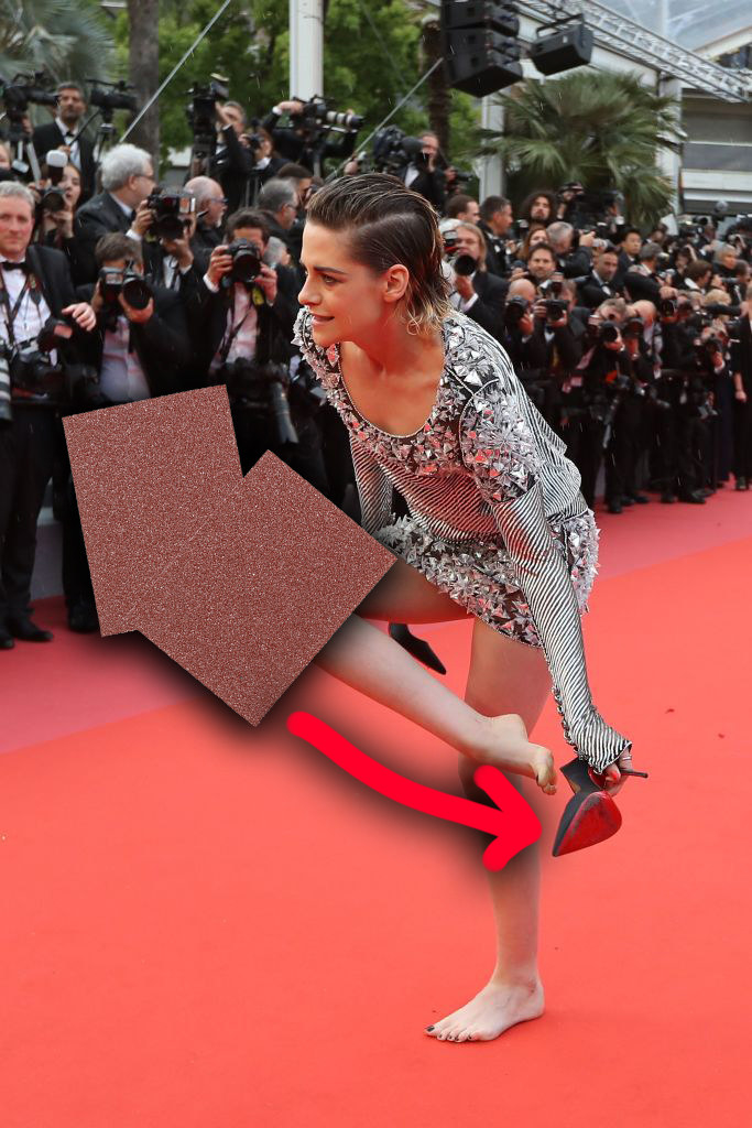 Kristen Stewart taking off her uncomfortable shoes at Cannes
