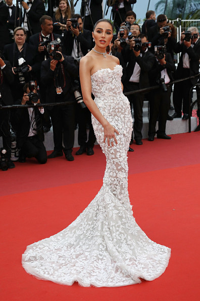 Olivia Culpo wearing a see-through dress at Cannes