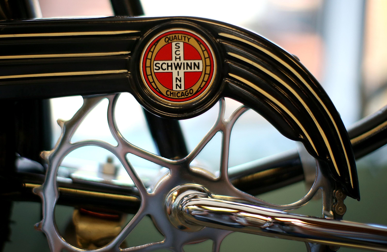 A Schwinn logo on a bicycle's main axle