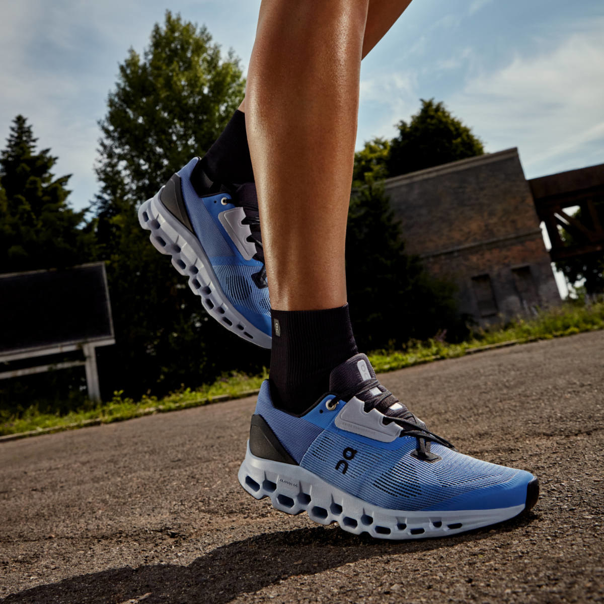 model wearing the blue sneakers