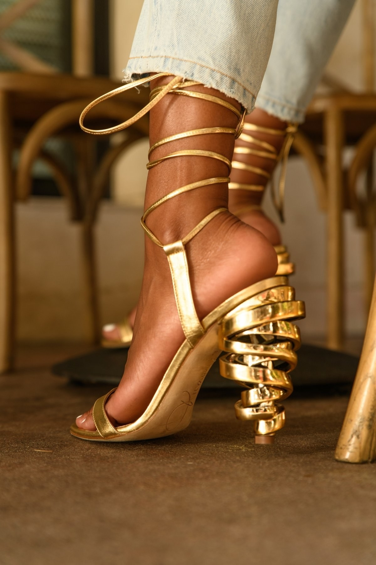 gold heels with a wrap-around detail on the heel with lace-up ankle detailing