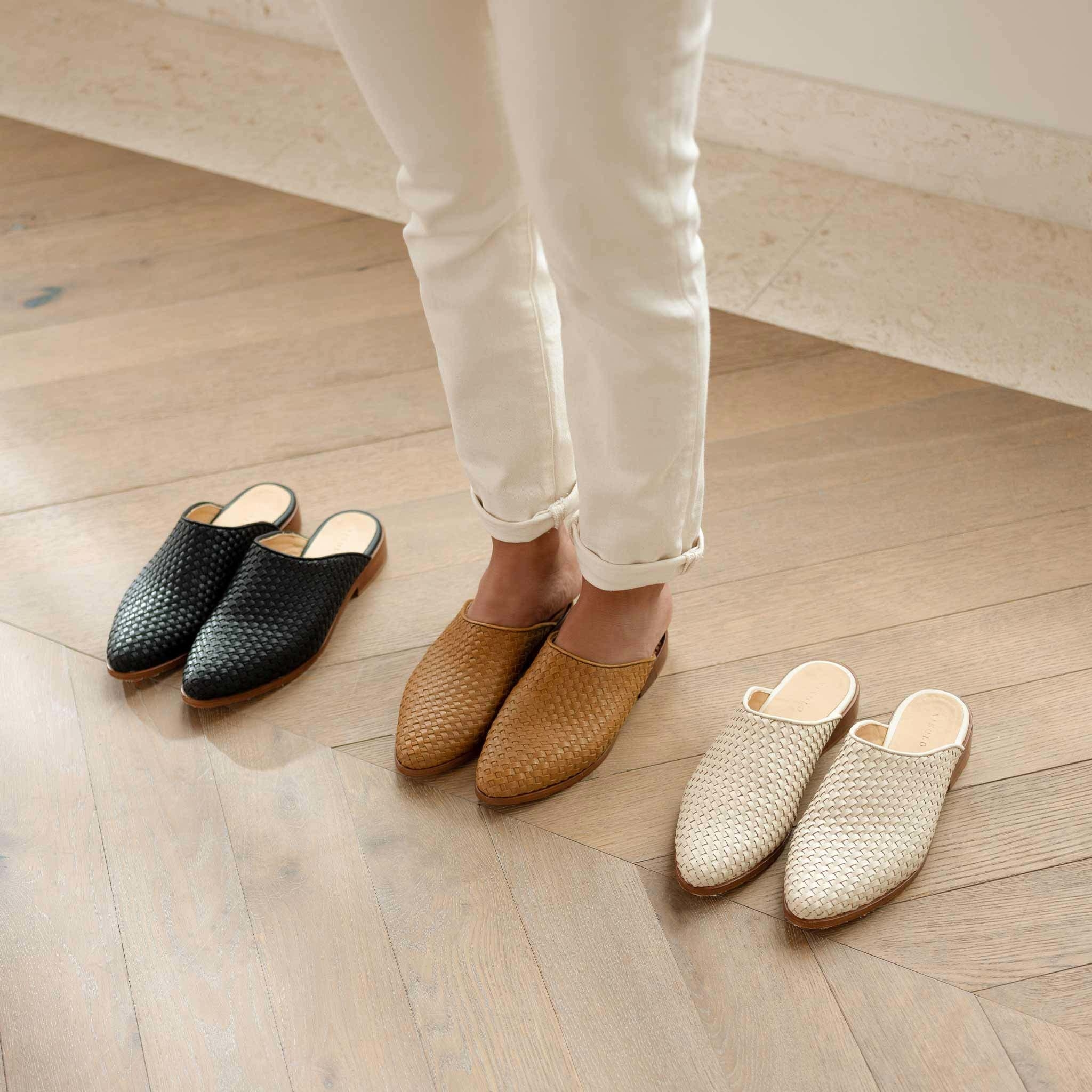 black, tan, and white, woven mules