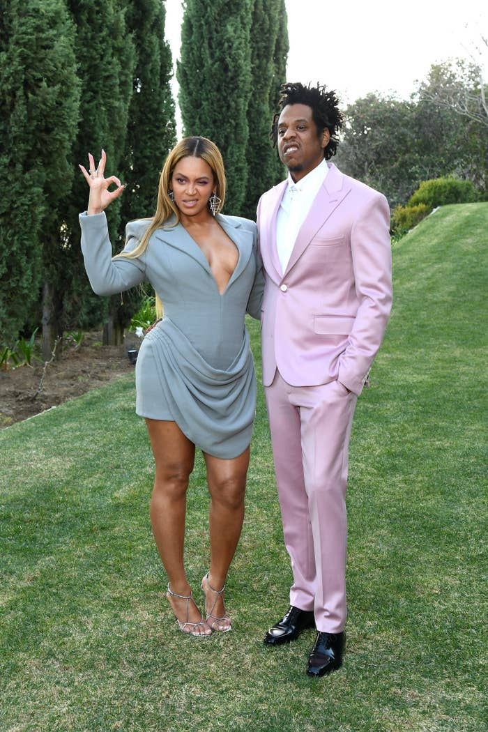 """Beyoncé and Jay-Z pose for a photo as Beyoncé puts up an """"OK"""" sign"""