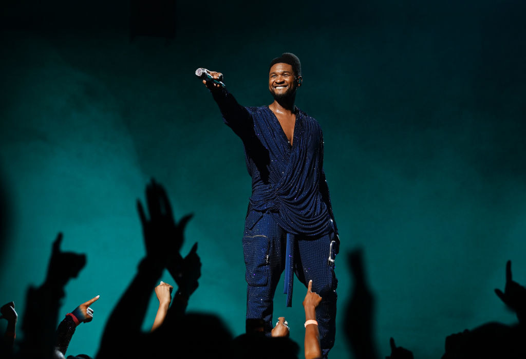 Usher performing on stage