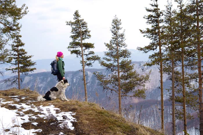 Woman on a hike with her dog.